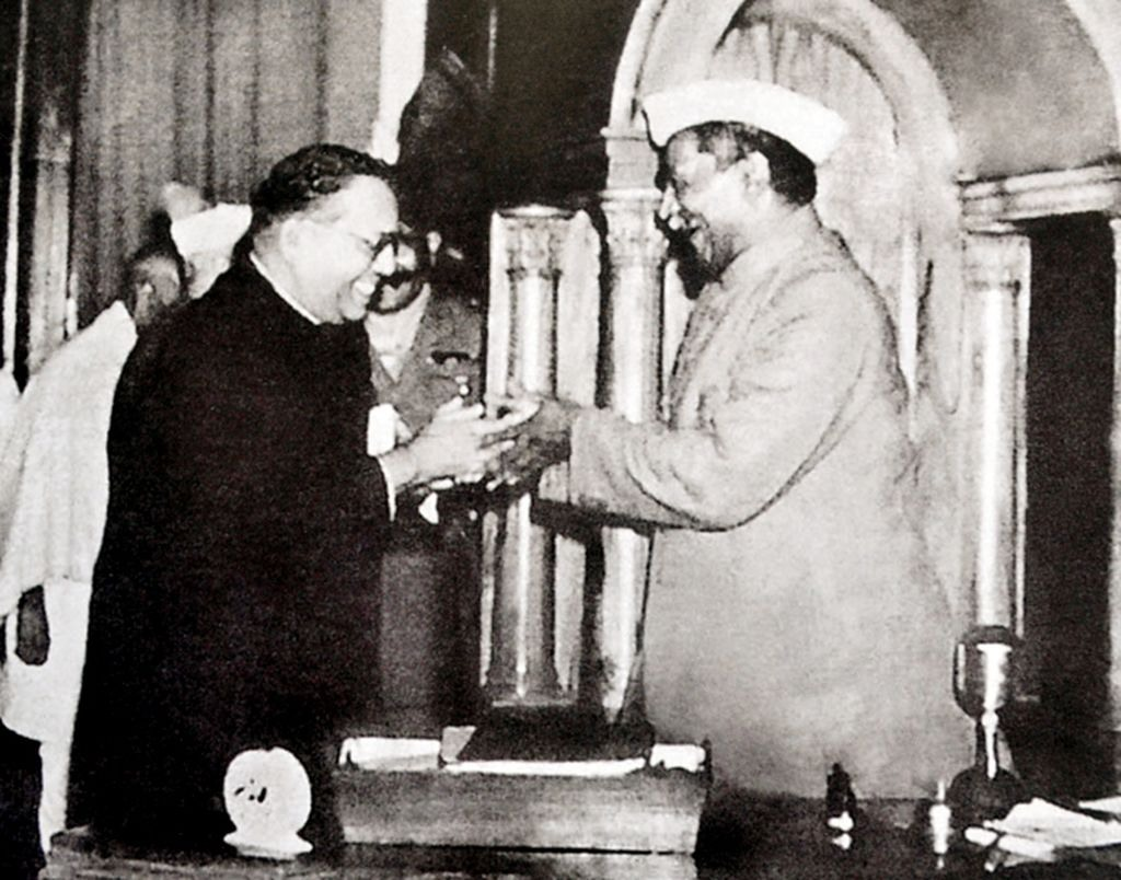 Babasaheb Ambedkar, chairman of the drafting committee, presenting the final draft of the Indian constitution to Constituent Assembly president Rajendra Prasad on 25 November 1949