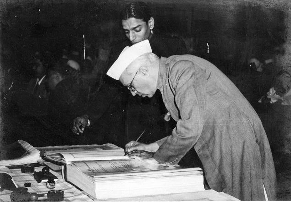Jawaharlal Nehru signing the constitution