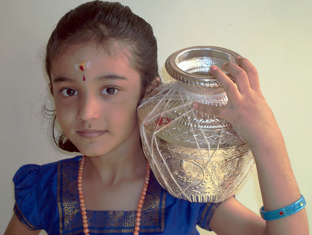 Pongal Celebration by girl 10 Interesting facts about Makar Sankranti you did not know, IndianYug