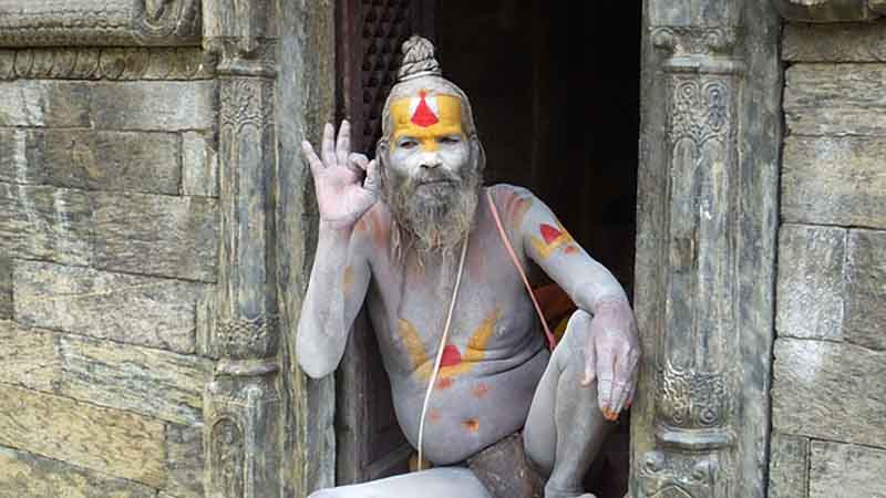 Sadhu in Shiva form of Unclad body covered with ashes