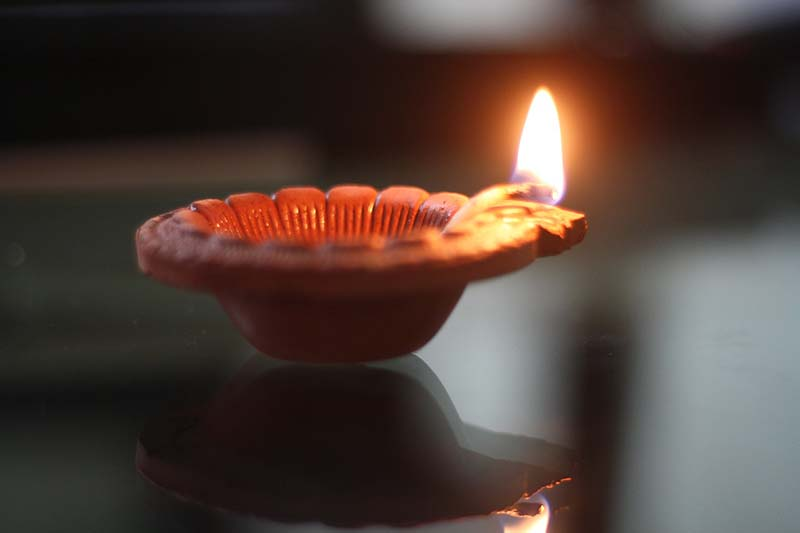 Diya is lighted up on Diwali- all about Diwali