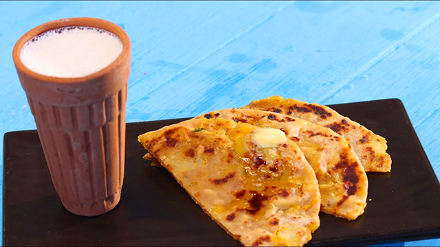 Have a taste of the local food, Parathas, with Lassi