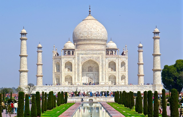 The myth about perfect symmetry of Taj Mahal