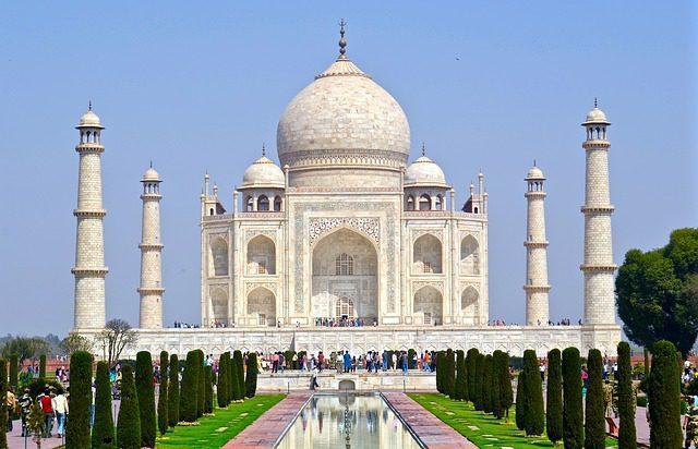 The myth about perfect symmetry of Taj Mahal