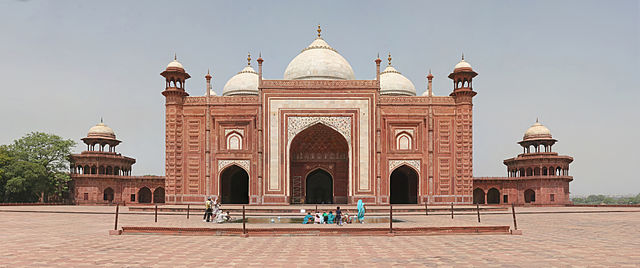 The western building, a mosque, faces the tomb.