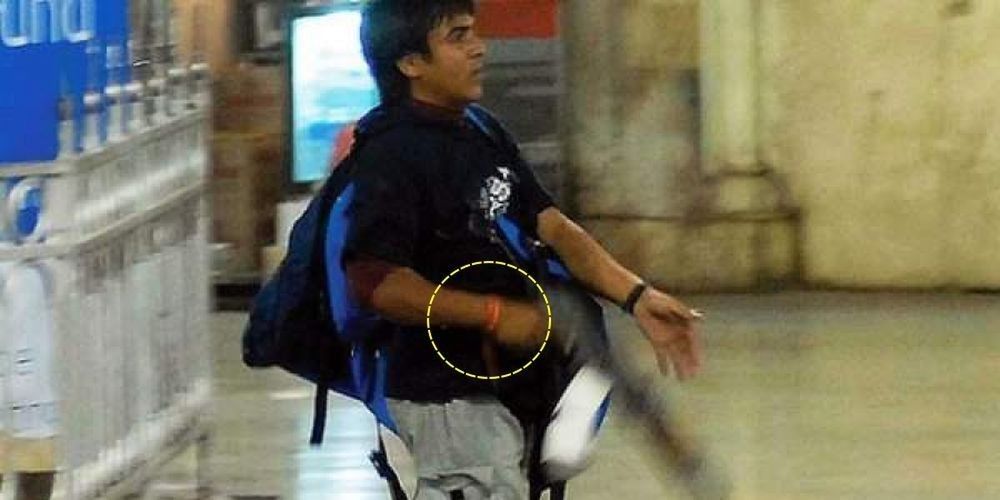 A picture of Kasab also shows him with a red thread tied around his wrist