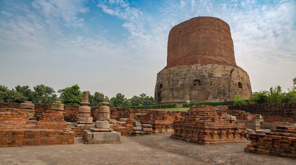 Dhamekh Stupa with ancient archaeological ruins at Sarnath, Varanasi, India