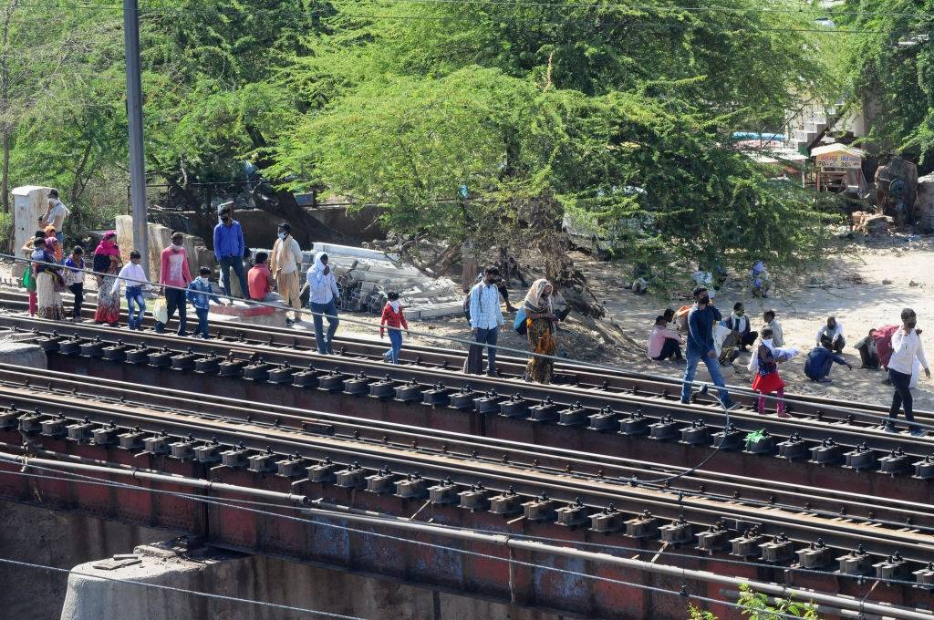 Migrant labours use railway tracks walk to their villages amid the nationwide lockdown, in wake of coronavirus (COVID-19) pandemic in New Delhi